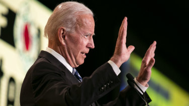 Biden gestures while speaking during the International Association of Fire Fighters (IAFF) Legislative Conference in Washington.