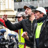 Police and the CFMEU were confronted by a high-vis clad crowd on Monday angry at vaccine mandates.