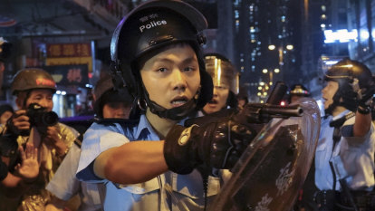 Police fire first live gun shot as weapons drawn in Hong Kong protests