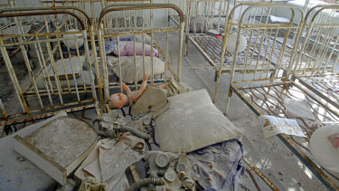 Children's toys and gas masks, covered by radioactive dust, on beds in an abandoned kindergarten in the ghost town of Pripyat, which was built nearly a mile from the Chernobyl nuclear plant, to house workers.