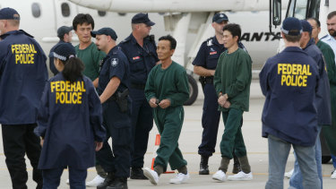Crew members of Pong Su being escorted by AFP