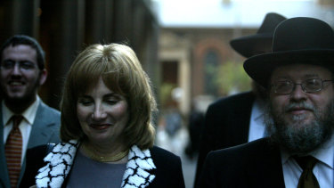 Pnina Feldman leaving a separate court case with her husband Rabbi Pinchus Feldman that also featured her brother Joseph Gutnick as a defendant.