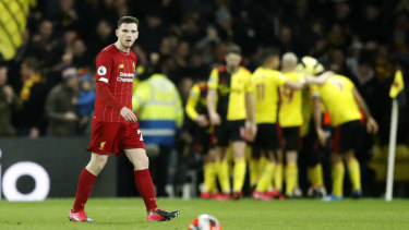 Liverpool's Andrew Robertson reacts after Watford's Troy Deeney scores his side's third goal at Vicarage Road.