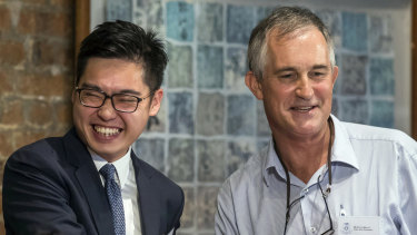The Financial Times Asia news editor, Victor Mallet, right, shakes hands with Andy Chan, founder of the Hong Kong National Party, at the Foreign Correspondents Club in Hong Kong.