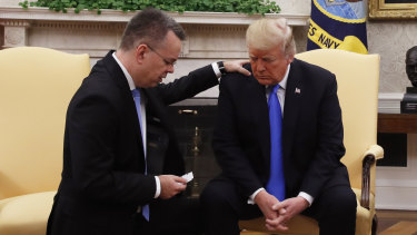 US President Donald Trump prays with American pastor Andrew Brunson in the Oval Office of the White House in 2018.
