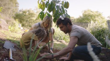 Damon Gameau plants a tree with his daughter and wife.
