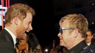 Prince Harry greets Elton John after the Royal Variety Performance at the Albert Hall in London in 2015.