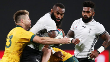 Setting a benchmark: James O'Connor throws himself into contact against Fiji's former NRL star  Semi Radradra at Sapporo Dome.
