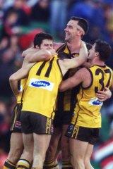 Paul Salmon celebrates with team mates.