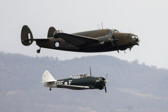 A Lockheed Hudson bomber (foreground) and a CA-16 Wirraway fly over Canberra during commemorations for the 75th anniversary of the end of World War II in Canberra last year.