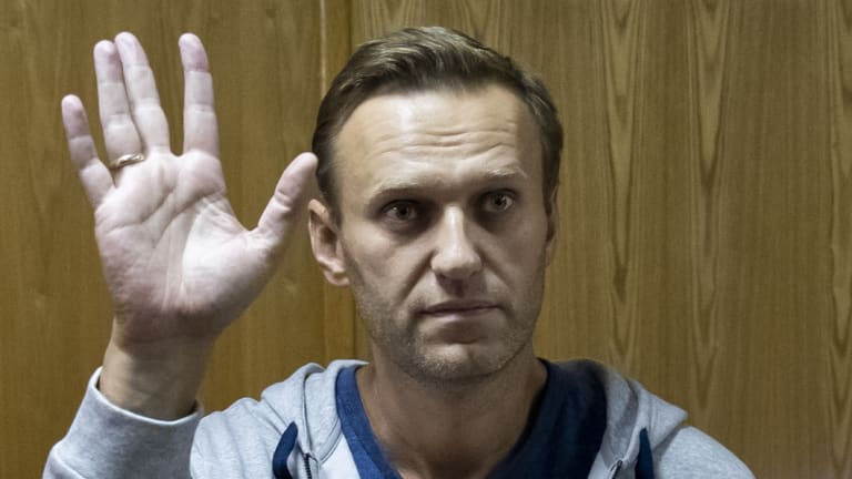 Russian opposition leader Alexei Navalny gestures in a court room in Moscow.