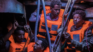 Sub-Saharan refugees and migrants, mostly from Eritrea, wait to be rescued by aid workers of Spanish NGO Proactiva Open Arms, in the lower deck of a wooden boat as they were trying to leave the Libyan coast and reach Europe last year.
