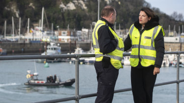 Britain's Immigration Minister Caroline Nokes talks to a Border Force officer in Dover on the weekend.