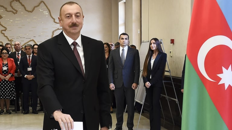 Azerbaijan President Ilham Aliyev casts his ballot at a polling station on April 11.