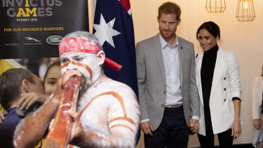Prince Harry and wife Meghan at a reception hosted by Prime Minister Scott Morrison with Invictus Games competitors in Sydney in 2018.