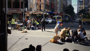 Emergency services tend to the wounded at the intersection of Elizabeth and Flinders streets on December 21, 2017.