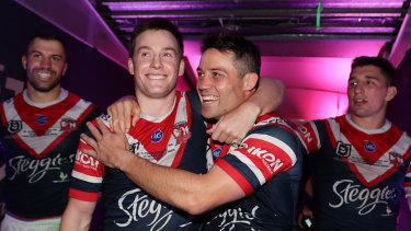 Luke Keary with Cooper Cronk after winning the 2019 Grand Final with the Roosters.