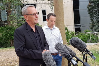 UQ scientists Professor Paul Young (left) and Professor Trent Munro in December 2020 announcing the vaccine was being halted.