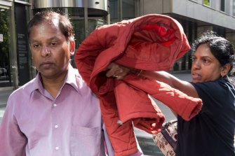 Kandasamy (left) and Kumuthini Kannan try to conceal their faces outside court in 2017.