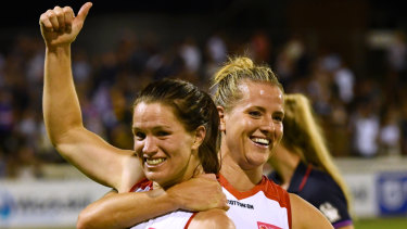 Emma Mackie (left) and Hannah Scott of the Western Bulldogs celebrate their round one win over the Crows.