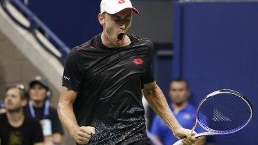 Giant-killer: John Millman reacts after winning a point against Roger Federer.