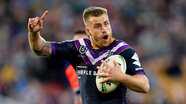 Too good: Melbourne's Cameron Munster celebrates against the Eels.