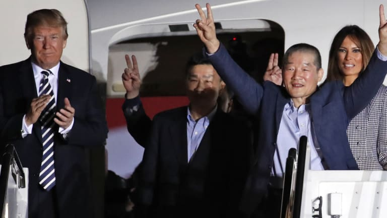 Donald Trump welcomes back three US prisoners released from detention in North Korea.