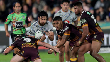 The wall: The Brisbane defence crowds out  Peta Hiku.