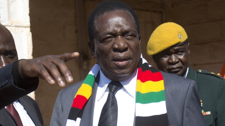 Zimbabwean President Emmerson Mnangagwa leaves the polling station after casting his vote in Kwekwe.