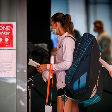 Tennis players who are not in hard quarantine leave the Grand Hyatt in Melbourne for training on January 20.