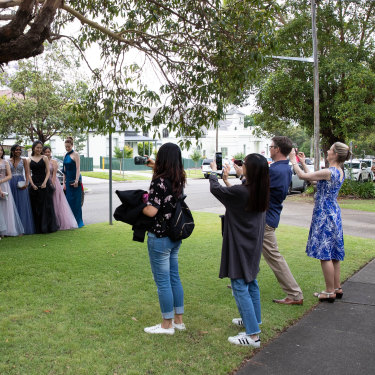 Parents and siblings look on as students from Strathfield Girls High School head to their school formal.