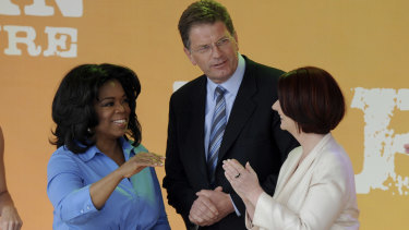Oprah Winfrey on stage at Federation Square in 2010 with former Premier Ted Baillieu and Prime Minister Julia Gillard.