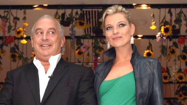 Philip Green, the billionaire owner of Arcadia Group, and model Kate Moss, at the opening of the Topshop store in New York in 2009.