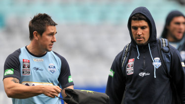 Mitchell Pearce (left) and Trent Barrett arrive for NSW training.