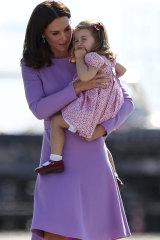 The Duchess of Cambridge, wearing an Emilia Wickstead dress, with Princess Charlotte in Berlin last year.