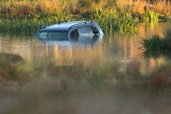 Akon Guode's car in the lake.