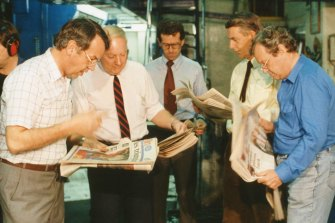 Steve Harris (centre), founding editor of <i>The Sunday Age</i>, and <i>Age</i> editor Creighton Burns (far right) with the first edition of the paper ever to leave the presses on August 19, 1989.