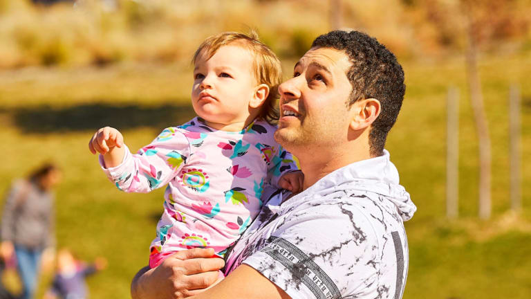 Domenic and Audrey Agresla, of Queanbeyan, watch the kites take to the sky over Googong.