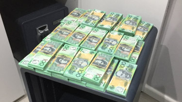 Cash seized during raids on Assure Protection Services, a Sydney security business that allegedly acted as a front to launder $100 million from organised crime groups.