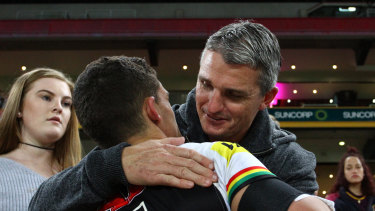 Together again? Ivan Cleary gives Nathan a hug after a Panthers game last season.