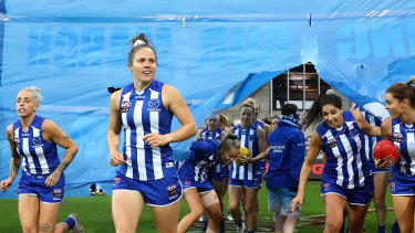 Hopping to it: Emma Kearney leads the Kangaroos out during the 2020 AFLW season.