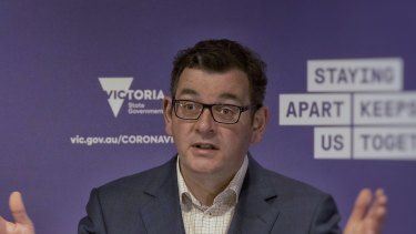 Still a long way to go: Premier Daniel Andrews outlines the road map on Sunday.
