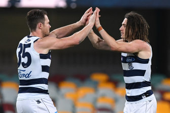 Gryan Miers and Patrick Dangerfield celebrate a goal.
