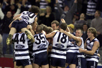 Geelong hero Peter Riccardi celebrates with teammates after his match-winning goal.
