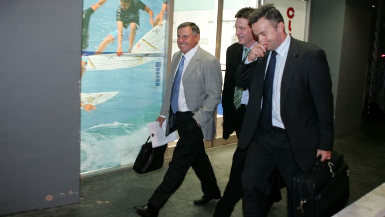Taking it in their stride: Warriors' director of football John Hart, chairman Maurice Kidd and chief executive Wayne Scurrah leave NRL HQ after being fined fined for salary cap breaches.