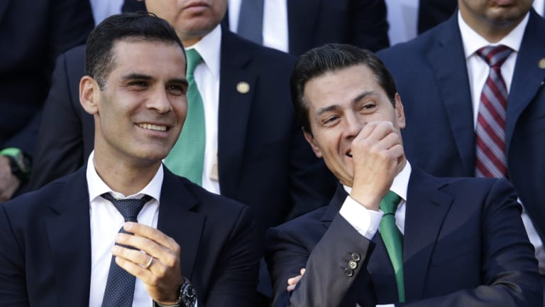 Mexican national soccer team captain Rafael Marquez, left, with Mexican President Enrique Pena Nieto during a ceremony to present the national flag to the team before the 2018 World Cup, at Los Pinos presidential residence, in Mexico City, last month.