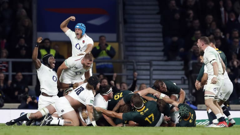 Rejoice: England players celebrate their narrow victory over South Africa.