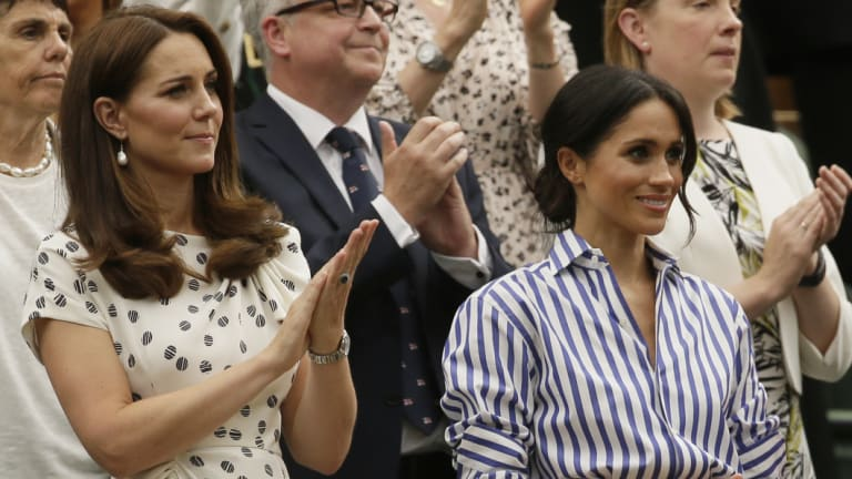 Kate, Duchess of Cambridge and Meghan, Duchess of Sussex, right, applaud after Novak Djokovic of Serbia defeated Rafael Nadal of Spain in the men's singles semifinal match.