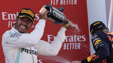 Customary: Mercedes driver Lewis Hamilton celebrates winning the Spanish Formula One Grand Prix.