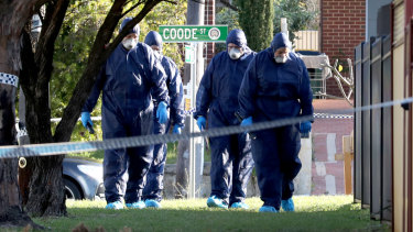 Forensic police officers inspect a property in Bedford. Five bodies were discovered at the home with homicide squad detectives investigating.